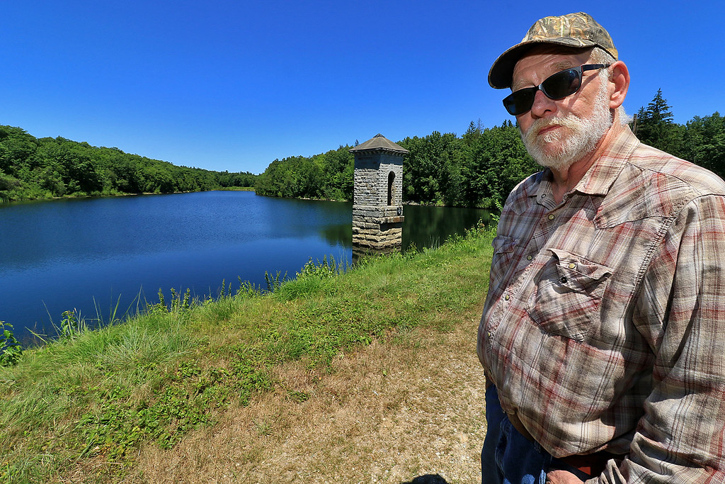 . Ron Derschamps a volunteer with the North County Land Trust talks about all he does while out at Crocker Conservation Land in Fitchburg on  Thursday, July 19, 2018. SENTINEL & ENTERPRISE/JOHN LOVE