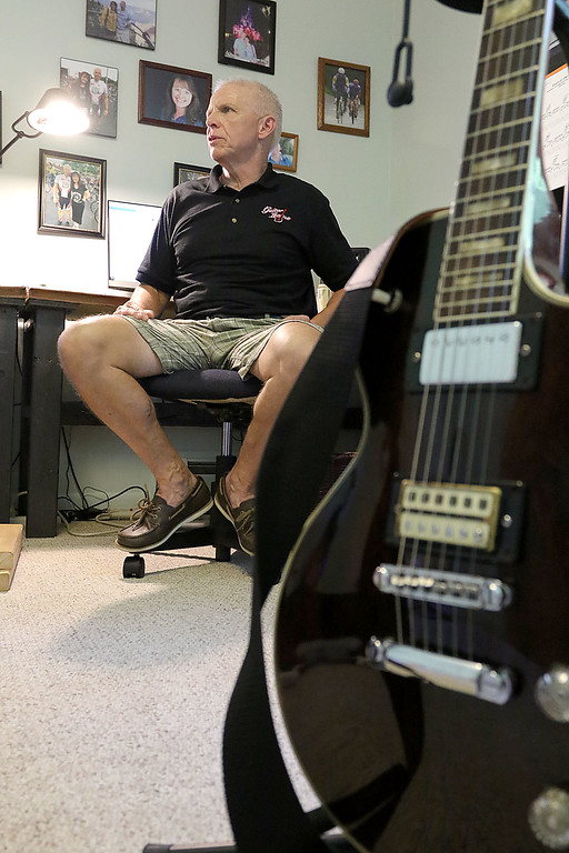 . Paul Murphy of Leominster talks about his new group Guitar League at his home on Wednesday afternoon. SENTINEL & ENTERPRISE/JOHN LOVE