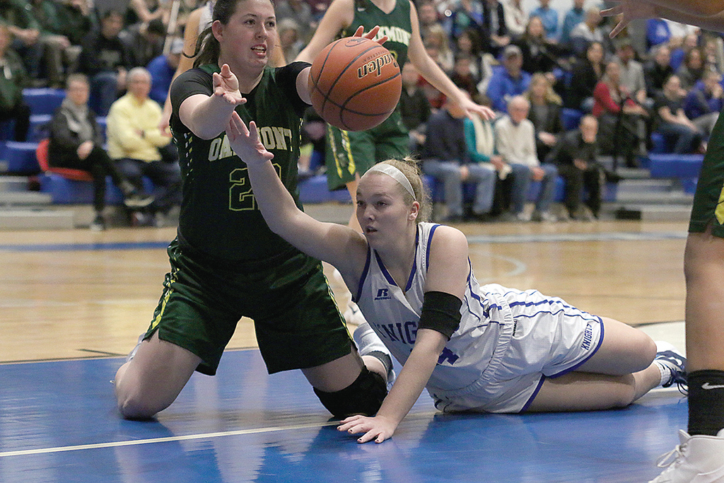 . Lunenburg Middle High School girls basketball team played a home game against Oakmont Regional High School on Tuesday afternoon. ORHS player Kylie Lison makes a pass from her knees as LMHS player Sarah Blomgren tries to stop her after they fought for a loose ball. SENTINEL & ENTERPRISE/JOHN LOVE