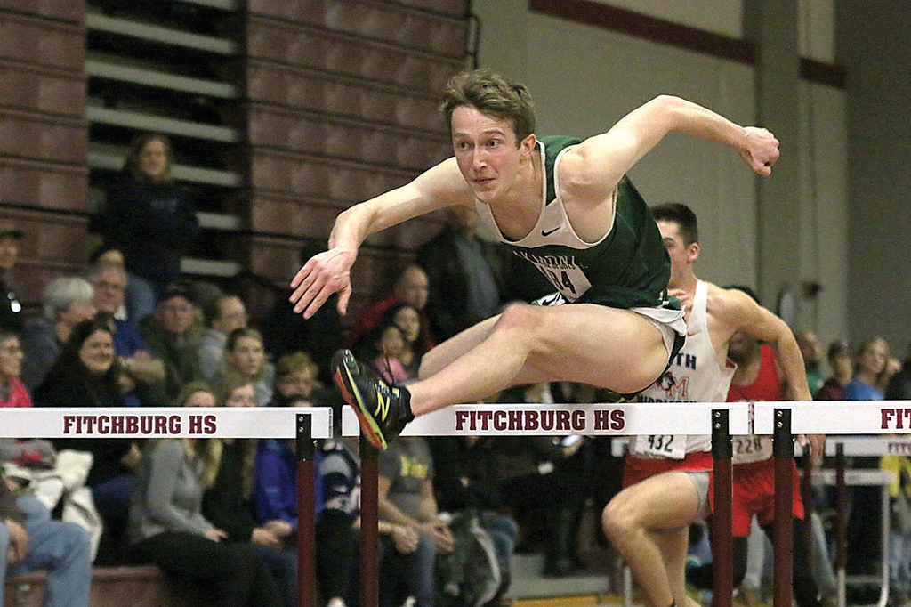 . Oakmont senior Ben Telicki competes in the hurdles at Friday meet held at Fitchburg High School. SENTIENL & ENTERPRISE/JOHN LOVE