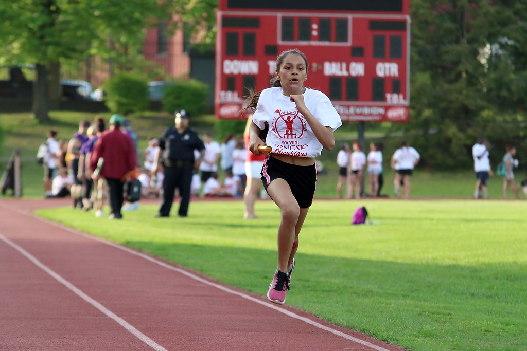 . 104th running of the Junior-Senior Relays were held at Crocker Field in Fitchburg, May 17, 2018. Longsjo Middle School fifth grader Samara Babineau comes competes in the relays  SENTINEL & ENTERPRISE/JOHNLOVE