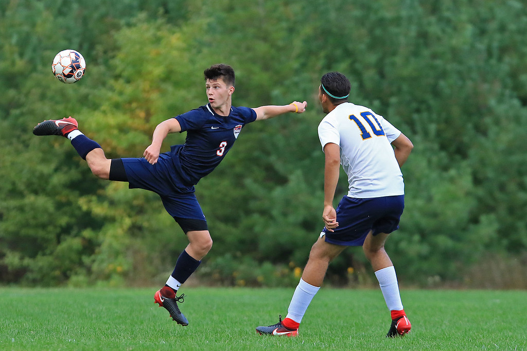 . Littleton High School boys soccer traveled to Townsend on Thursday afternoon to play North Middlesex Regional High School. LHS player Leandro Alves watches as NMRHS\'s Jacob Talmer does not let the ball get away from him as he does a back kick to try and get the ball. SENTINEL & ENTERPRISE/JOHN LOVE