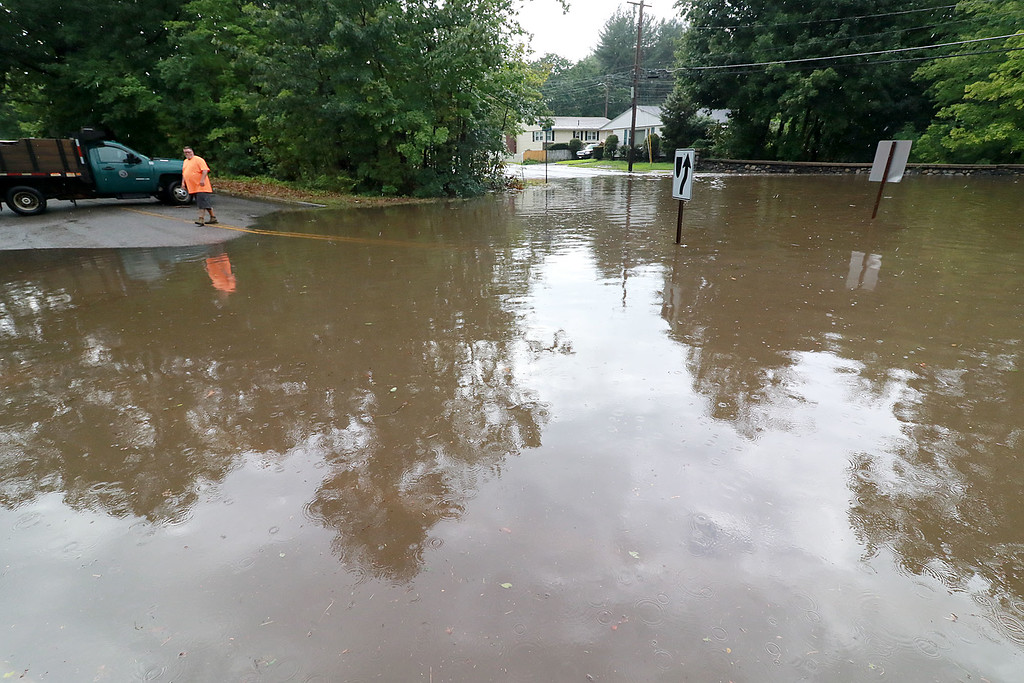 . Leominster DPW workers closed off Washington Square due to the area being flooded after the skys opened up around 2 p.m. The square is were Washington Street, Grove Avenue and North Main Street meet. SENTINEL & ENTERPRISE/JOHN LOVE
