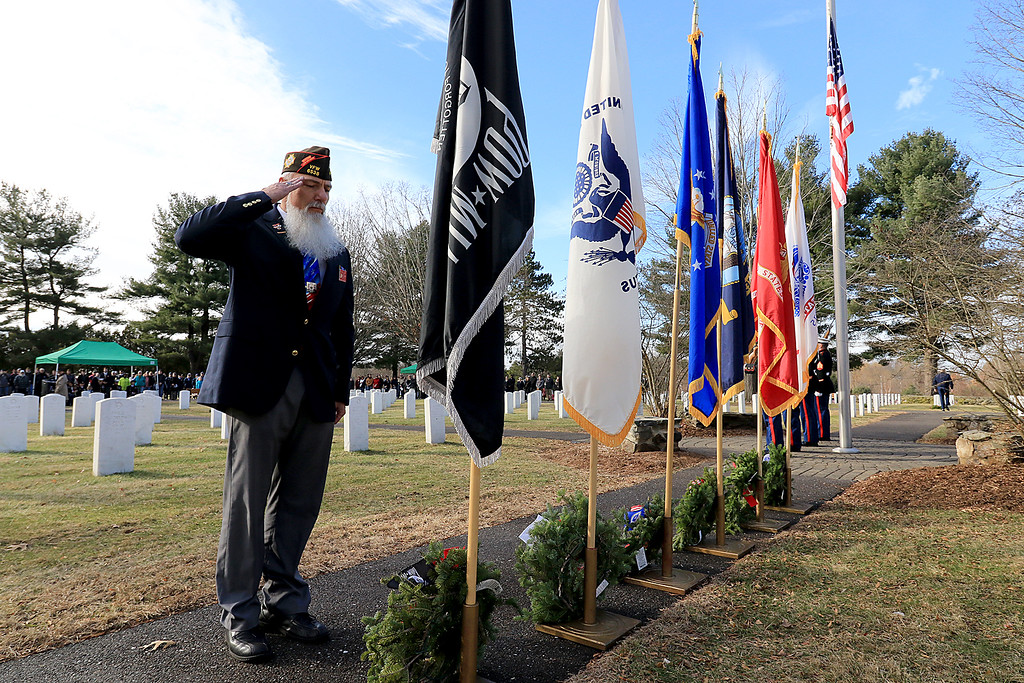 . A Wreaths Across America event was held at the Fort Devens Cemetery on Patton Road Saturday morning, December 15, 2018. State Junior Commander for the VFW Russell Jobe salutes after placing a wreath at the base of the POW-MIA flag during the ceremony. SENTINEL & ENTERPRISE/JOHN LOVE