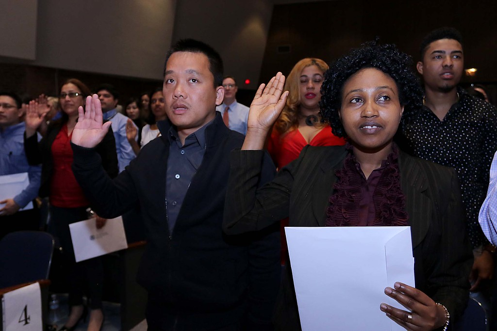 . Vandy Ngeth from Cambodia who now lives in Lowell and Jeanne D\'arc Kanyange from the Congo who also now lives in Lowell sear in as new citizens during the naturalization ceremony held at the Weston Auditorium at Fitchburg State University Friday, May 4, 2018. SENTINEL & ENTERPRISE/JOHN LOVE