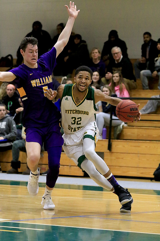 . Fitchburg State University basketball played Williams College on Thursday afternoon at FSU. FSU\'s Jordan Jones tries to get around WC\'s James Heskett. SENTINEL & ENTERPRISE/JOHN OVE