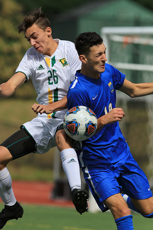 . Worcester State played Fitchburg State University boys soccer on Saturday, September 22, 2018. FSU\'s Jeremiah Maki and WS\'s Clayton DeMelo fight for control of the ball. SENTINEL & ENTERPRISE/JOHN LOVE