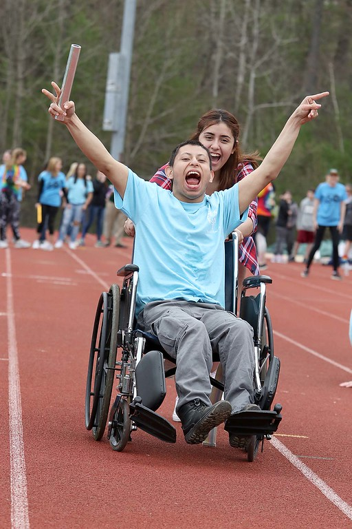 . Special Olympics was held at Elliot Field Athletic Complex in Fitchburg on Friday. Participating in a relay race at the games was Leominster High School junior Anders Luna, 18, who holds the baton and showing off how much fun he was having as senior Karina Rosado, 18, pushed him down the track. SENTINEL & ENTERPRISE/JOHN LOVE