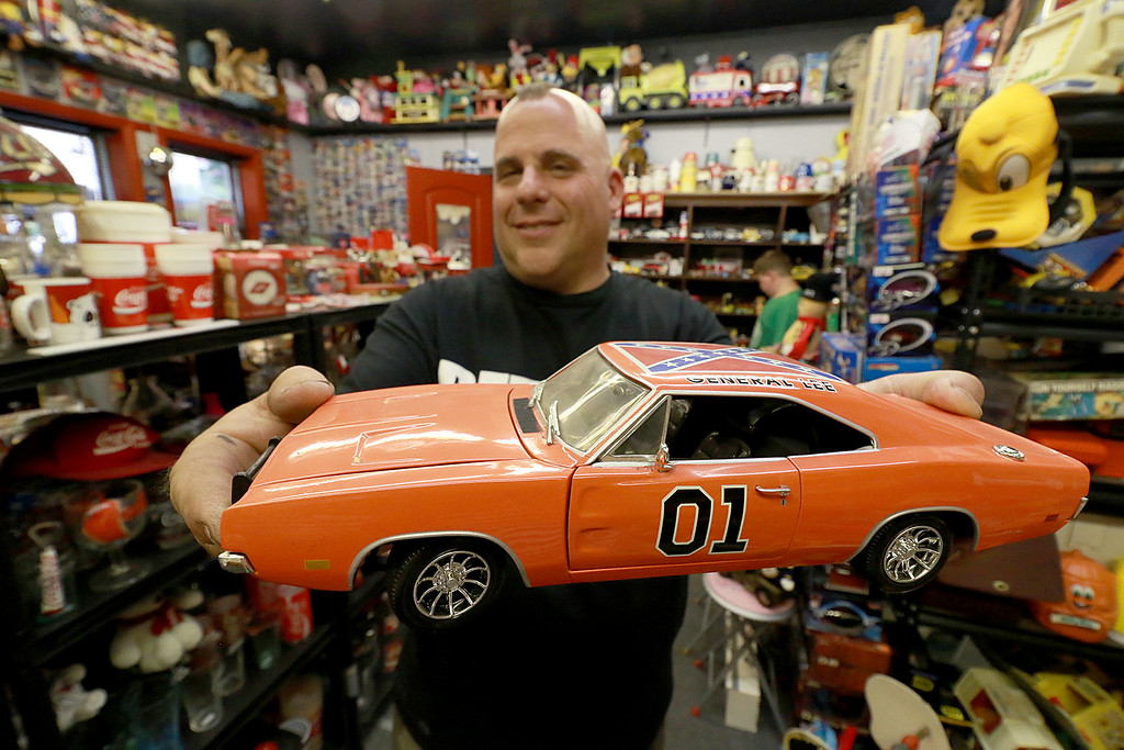 . Dave LaPlante owner of Big D\'s Auto Detailing in Fitchburg likes cars but also has a love for vintage toy\'s. At his shop in Fitchburg in a back room is where he keep many of the toys he has collected.  In his collect is the General Lee from the Dukes of Hazzard TV Show. SENTINEL & ENTERPRISE/JOHN LOVE