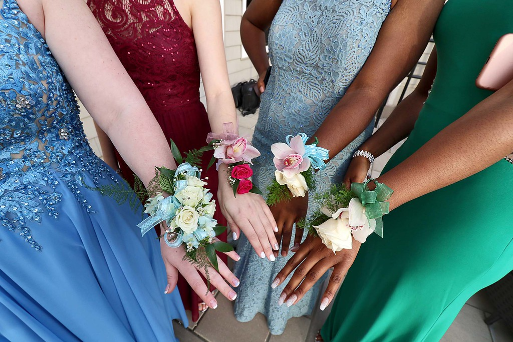 . Ayer Shirley regional High School Prom was held a the Colonial Hotel in Gardner on Friday night, May 18, 2018. Some of the ladies showed off their flowers for a picture. SENTINEL & ENTERPRISE/JOHN LOVE