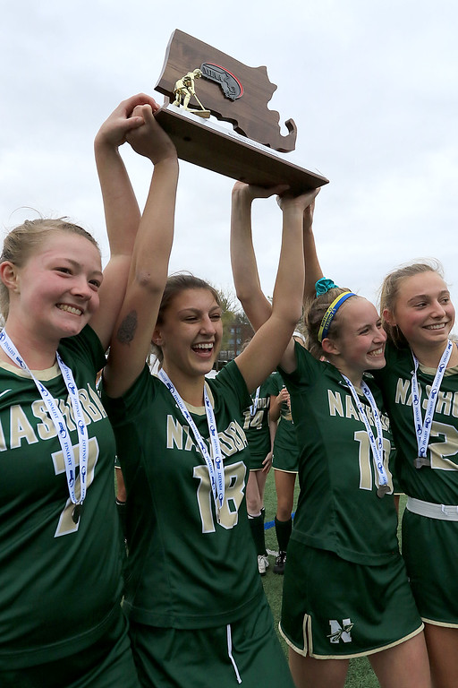 . Nashoba Regional High School Field Hockey played Somerset Berkley Regional High School on Saturday for the Division 1 state championship at Worcester Polytechnic Institute. NRHS lost 2 to 1. NRHS players Natalie Brown, Erin Mehigan, Chloe Spedden and Jane Bonazzoli hold up their trophy for their fans after the game. SENTINEL & ENTERPRISE/JOHN LOVE