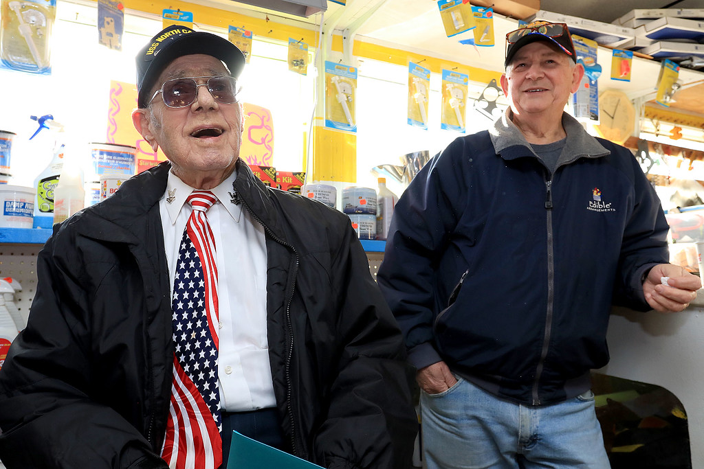 . Fred Cuddy From Lunenburg who turned 95 on Saturday was surprised by his friends and fellow veterans with a hat that they got Lt. Jason Poitras, who works on Devens, to give to him and it was from the USS North Carolina, the boat on which he served in WWII. Wearing the hat he tells some stories. Just behind him is Army veteran James Jordan. SENTINEL & ENTERPRISE/JOHN LOVE