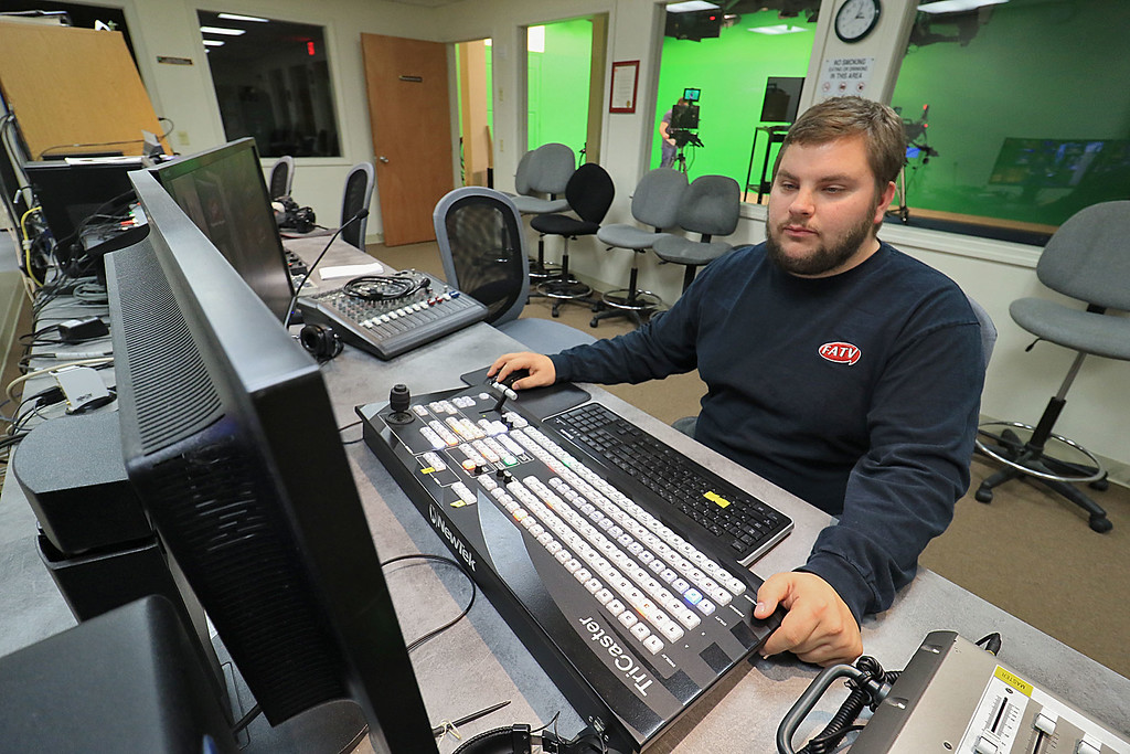 . FCC haas a proposal that could cut funding to local access cable stations like Fitchburg Access Television. FATV\'s Education and Production Manager Dave Oster works in the control room on the FATV Sports Report at their office on Friday. SENTINEL & ENTERPRISE/JOHN LOVE