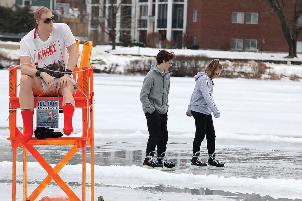 . Macy Atkinson, 15, and Brock Hoffey, 14, skate on Rockwell pond in Leominster on Saturday during the skate with Private Rocky Rockwell, seen in foreground, to help promote the Ice-Out fundraiser. SENTINEL & ENTERPRISE/JOHN LOVE