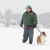 A little snow and temperatures in the low 30's did not stop Matk Testa of Leominster, who lives by Lake Whalom, and his dog Palmer, a shetland sheepdog, from taking a walk on the lake Wednesday afternoon. During his walk he got to see ice fisherman Bruce Maki of Fitchburg catch a yellow belly perch. SENTINEL & ENTERPRISE/JOHN LOVE