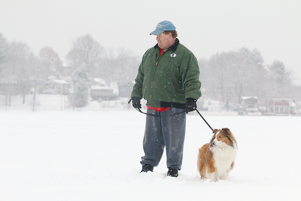 . A little snow and temperatures in the low 30\'s did not stop Matk Testa of Leominster, who lives by Lake Whalom, and his dog Palmer, a shetland sheepdog, from taking a walk on the lake Wednesday afternoon. During his walk he got to see ice fisherman Bruce Maki of Fitchburg catch a yellow belly perch. SENTINEL & ENTERPRISE/JOHN LOVE