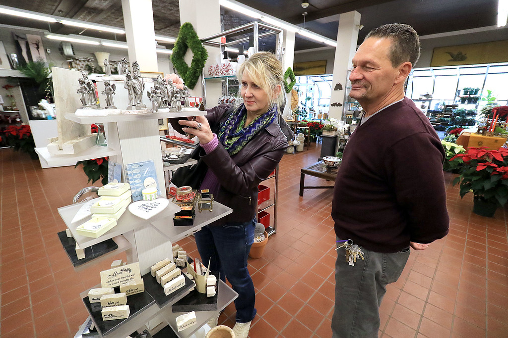 . Small Business Saturday was held this year on November 24, 2018. Many businesses in the North Central region participated in the event to help people shop local. Jamie and Alan Millett of  Fitchburg look over some of the many items at DeBonist & Davin Florist on Main Street in Fitchburg. SENTINEL & ENTERPRISE/JOHN LOVE