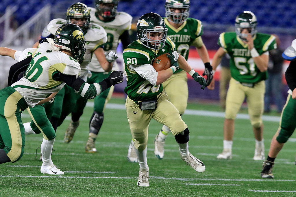 . Nashoba Regional High School\'s Brendan Lee rinds some running room during their win over Dighton-Rehoboth Regional High School at Gillette Stadium in Foxborough on Friday night, November 30, 2018. SENTINEL & ENTERPRISE/JOHN LOVE