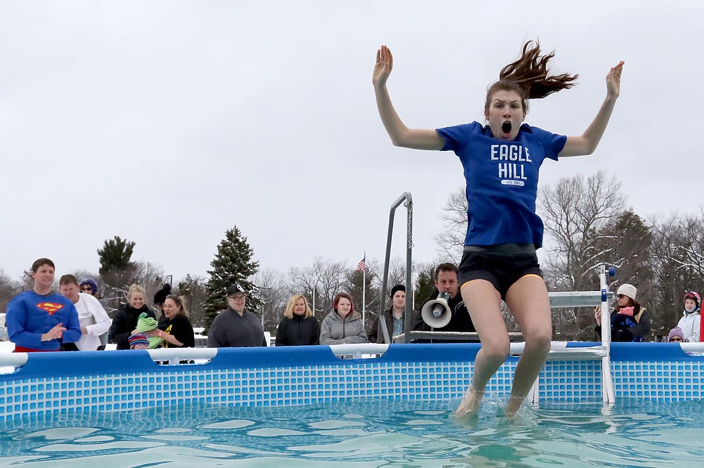 . Annie Schafer, 18, from Dover MA shows on her face how cold the water is as her feet touch the water during her participation in the 2018 Wachusett Polor Dip to raise money for Camp Sunshine at Wachusett Mountain Ski Area in Princeton on Saturday, March 10, 2018. The event raised over $50,000 dollars for the camp. SENTINEL & ENTERPRISE/JOHN LOVE