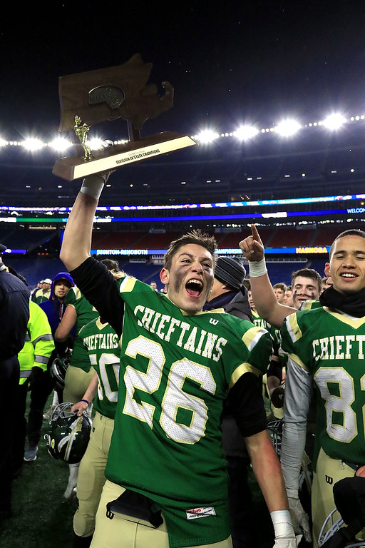 . Nashoba Regional High School player John Duros holds up the Superbowl trophy after their win over Dighton-Rehoboth Regional High School at Gillette Stadium in Foxborough on Friday night, November 30, 2018. SENTINEL & ENTERPRISE/JOHN LOVE