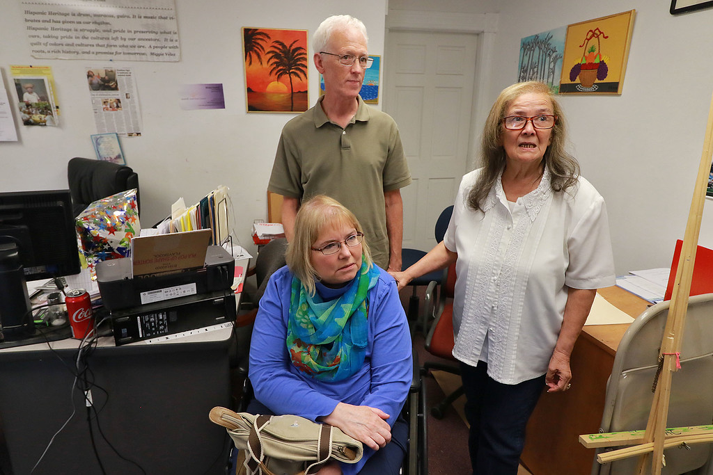. Cheryl and Jean-Pierre Boissy volunteers at the Leominster Spanish American Center pose with Director of the center Neddy Latimer, July 31, 2018. Cheryl, a board member at the Spanish American Center, started volunteering there after a multiple sclerosis diagnosis meant she could no longer work full time as a social worker. SENTINEL& ENTERPRISE/JOHN LOVE