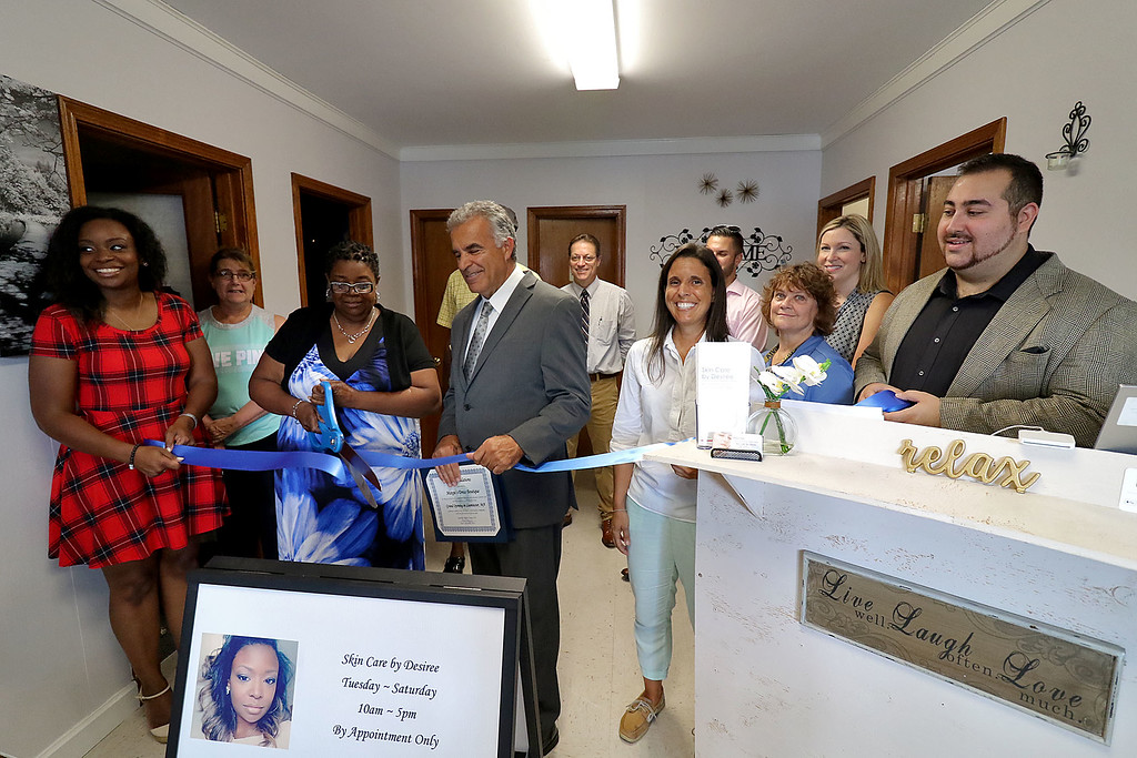 . A ribbon cutting was held for three new companies at 59 Merriam Avenue in Leominster. There is Skin Care by Desiree, Margie\'s Dress Shop and Glammy D\'s Jewelry & Accessories. Desiree Hall, on left, and Leominster Mayor Dean Mazzarella stand with Ruby Hall as she cuts a ribbon for her new business Glammy D\'s Jewlery and Accessories on Wednesday afternoon. SENTINEL & ENTERPRISE/JOHN LOVE
