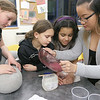Some of the students at the Boys & Girls Club of Fitchburg and Leominster got to learn how to make lipstick at the club on Tuesday afternoon. Program instructor Tina Huynha  pours out the mixture as  students, from left, Kalli LeCompte, 11, form Leominster, Brenna Gendron, 7, from Leominster, and Gina Rivera, 10, from Leominster help her out. SENTINEL & ENTERPRISE/JOHN LOVE
