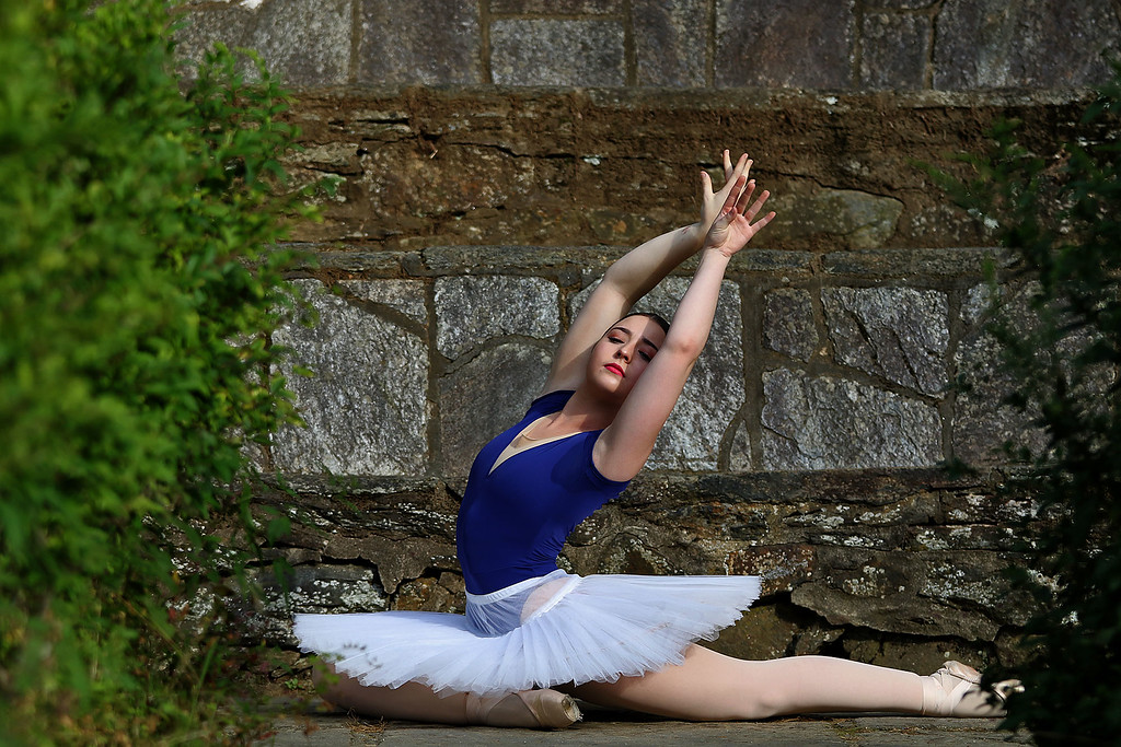 . Pre professional ballet dancer Aislinn Paisley Hubbard, 16, of Fitchburg was accepted to Kyiv Choreographic College in the Ukraine. She show off a few of her dance moves after talking about her life and dancing at Coggshall Park in Fitchburg Friday afternoon. SENTINEL & ENTERPRISE/JOHN LOVE
