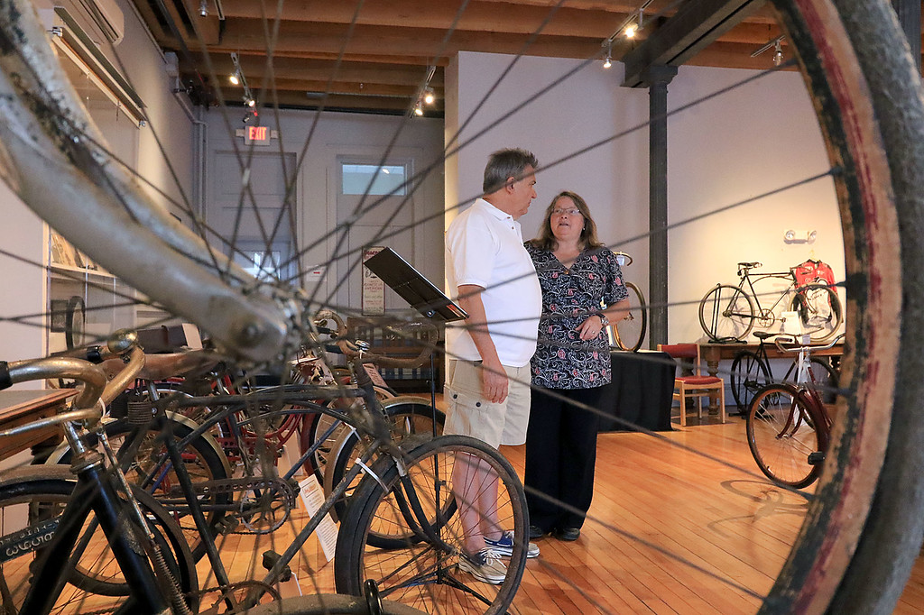 . Fitchburg Historical Society Director Susan Navarre and Peter Capodagli the Iver Johnson show organizer at the Fitchburg Historical Society as they talk about the Iver Johnson bicycle talk coming up at the Historical Society. SENTINEL & ENTERPRISE/JOHN LOVE