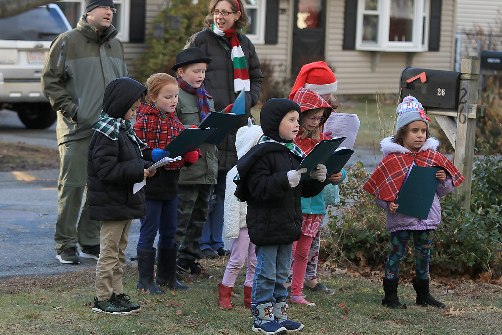 . Theresa Letarte, 7, was watching some old Christmas movies and decided she wanted to go caroling. She talked her family and friends into doing it. Here they all sing at one of the houses in her neighborhood. SENTINEL & ENTERPRISE/JOHN LOVE