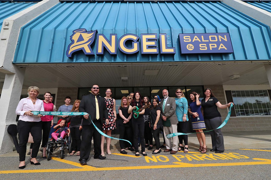 . Angel Salon & Spa held a ribbon cutting for their new place on Thursday afternoon, May 17, 2018. Owner of Salon Angelica Jimenez cuts the ribbon with members of the North Central MA. Chamber of Commerce, employees, family and city officials. SENTINEL & ENTERPRISE/JOHN LOVE