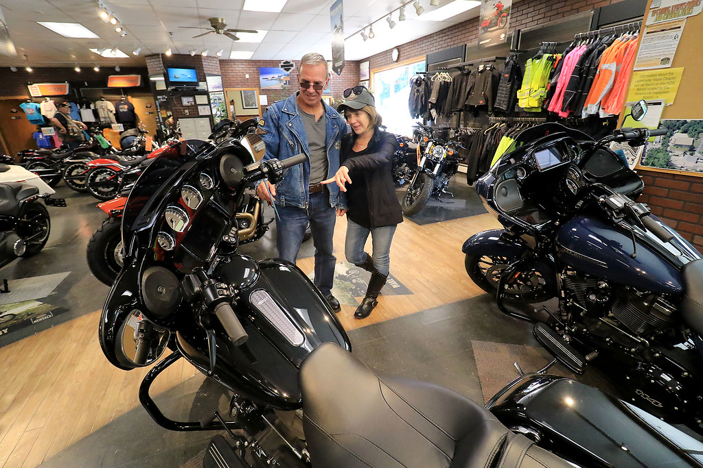 . American Harley-Davidson held an open house on Saturday, September 29, 2018. Rock and Christine Lapointe from Palmer look over some the bikes in the shop during the open house. SENTINEL & ENTERPRISE/JOHN LOVE