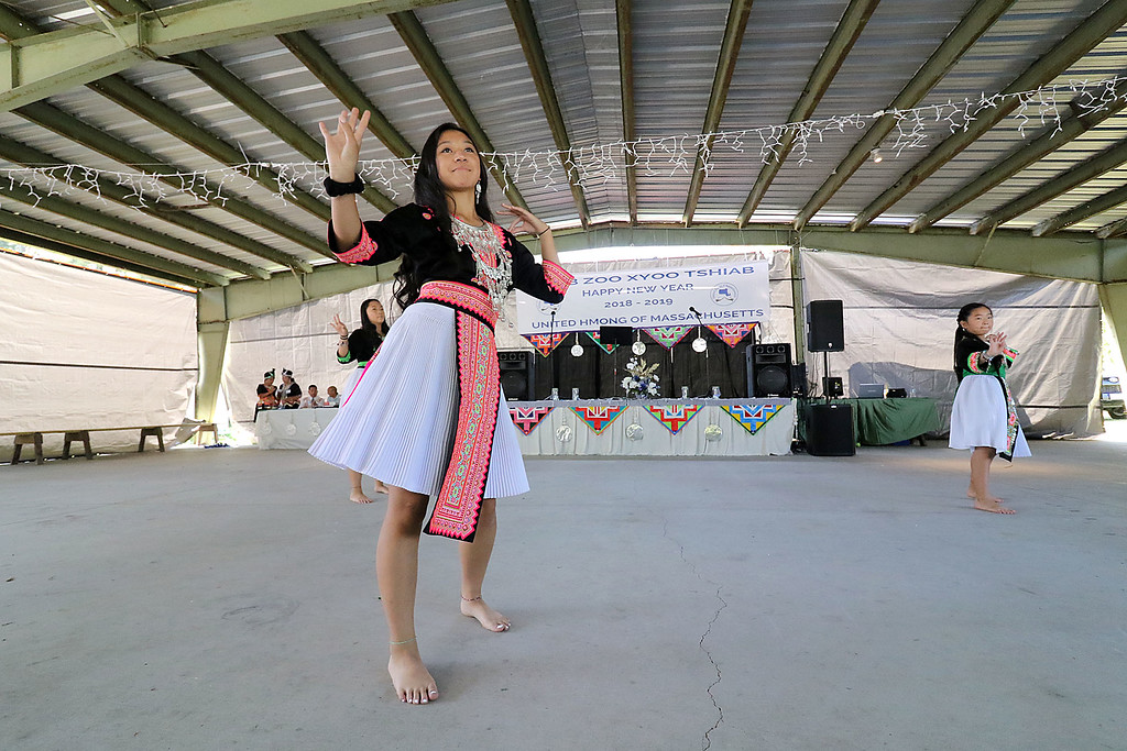 . The Hmong community of Fitchburg held its New Year\'s Festival on Saturday, September 1, 2018 at Finnish Center of Saima Park. Emily Khang, 13, from Attleboro performs at the celebration. Behind her, also from Attleboro, is Brianna Khang, 15, and Mikaela Lam, 10. SENTINEL & ENTERPRISE/JOHN LOVE