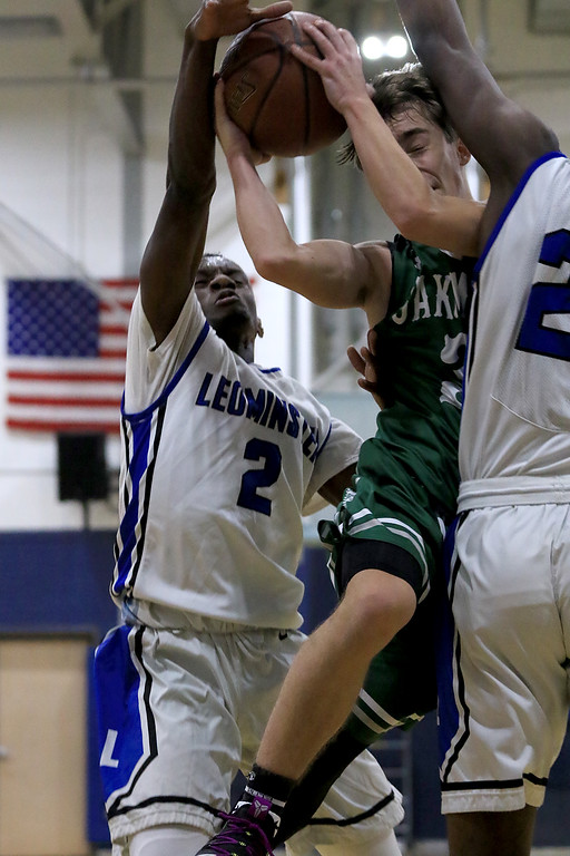 . Leominster High School basketball team played Oakmont Regional Hihg School on Wednesday night, December 12, 2018. LHS\'s (#2) Regun Kionga and (#21) Givensky Pierre-Louis try and stop ORHS\'s Evan Pappas as he drives to the basket. SENTINEL & ENTERPRISE/JOHN LOVE