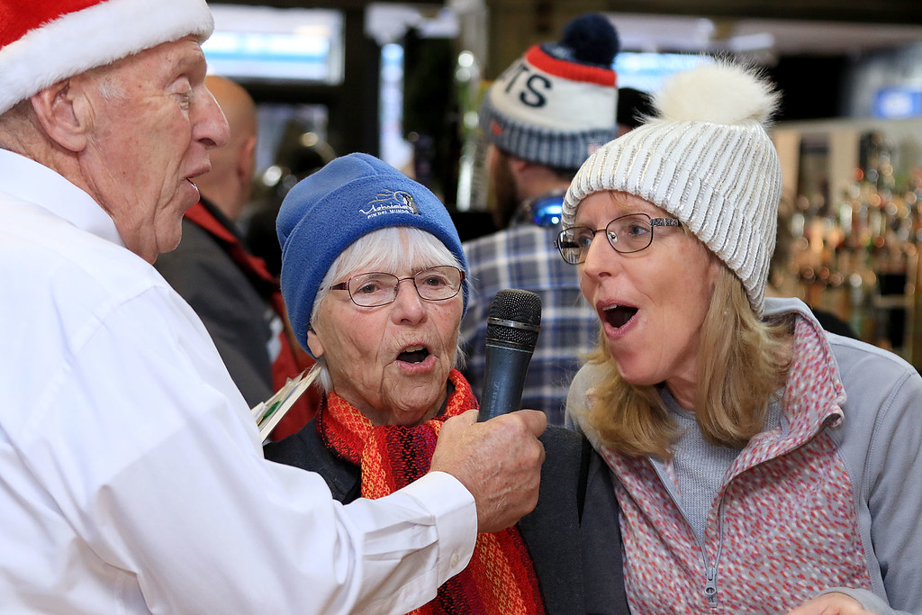 . Memories on Main Street Fitchburg\'s holiday festival was held on Saturday, December 8, 2018. Bob kelly with the International Veterans Chorus got the audience involved in one of the Christmas songs they sang. Singing with him as he walk through the crowd is Annette Kelly and Kathy Renda of Fitchburg. SENTINEL & ENTERPRISE/JOHN LOVE
