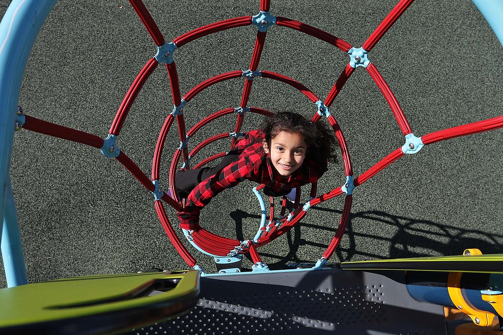 . The warm 55 degree weather on Tuesday was a perfect time for Arianna Curtis, 4, to play around at Louis Charpentier Playground on Third Street in Leominster with her mom Damaris Curtis. SENTINEL & ENTERPRISE/JOHN LOVE