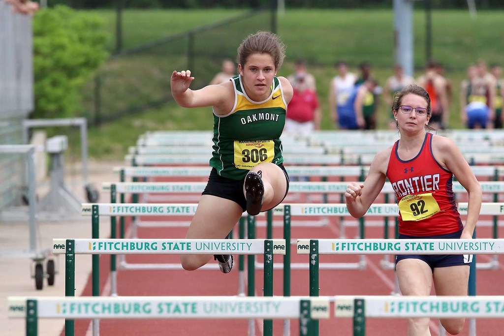 . Oakmont Regional High School senior Abigail Tata competes in the 100 hurdles during the Central/Western Mass. Division 2 track meet on Saturday at Elliot Field Athletic Complex at Fitchburg State University. SENTINEL & ENTERPRISE/JOHN LOVE