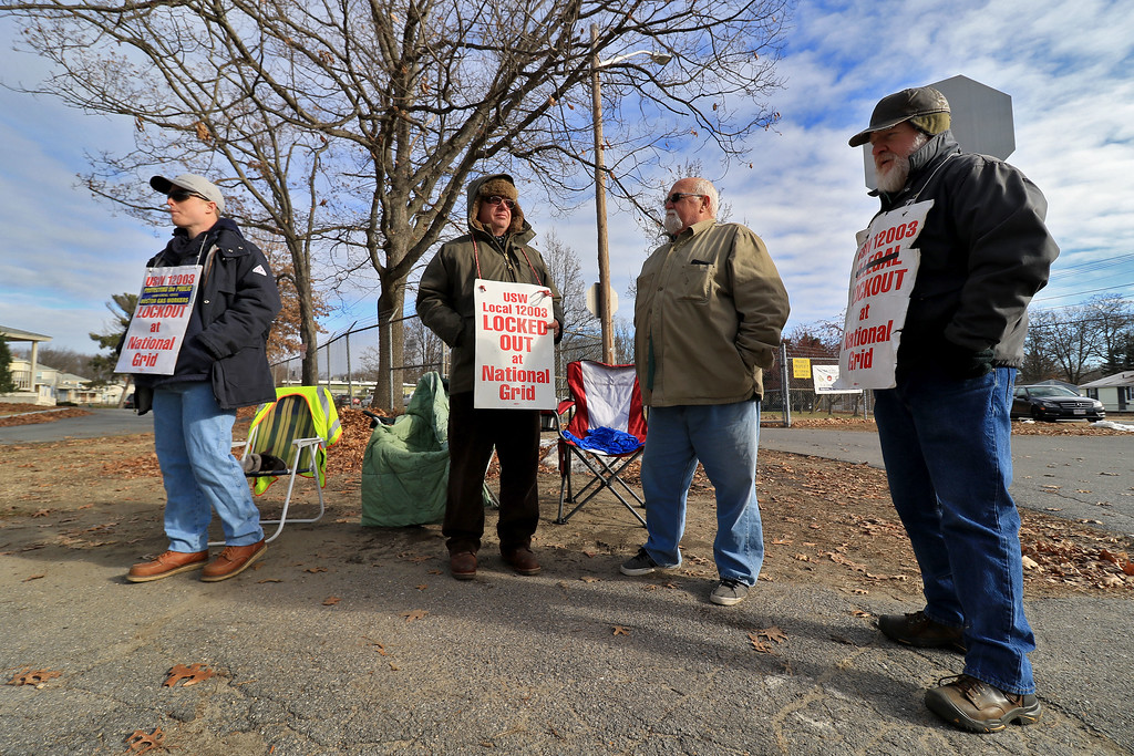 . Employees of National Grid Gas Company stand outside their facility in Leominster with signs protesting the lockout that started on June 25, 2018. National Grid could not reach an agreement with their Union Local USW 12003 so these employees have been out of work since June with no health care. on December 25 it will have been 6 months. Their unemployment checks with stop on January 1st they said. From left is Bryan Peters, Greg Dodge, Mike Callahan and Dan Cameron. SENTINEL & ENTERPRISE/JOHN LOVE