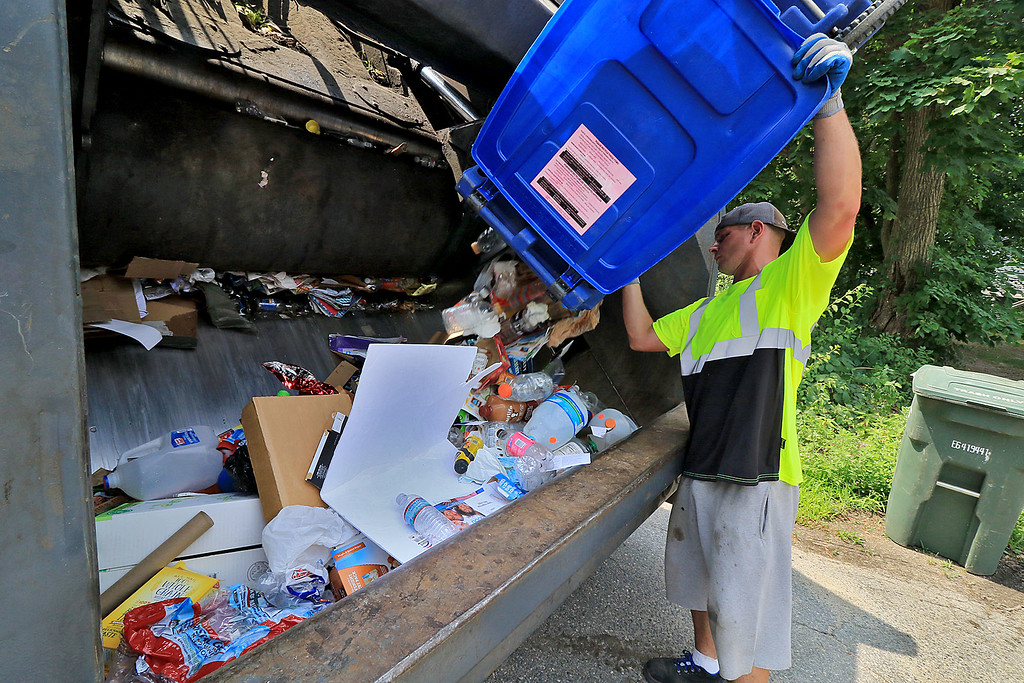 . Employees of G.W. Shaw & Son, Inc. collect recycling in Leominster on Tuesday morning. Adam Pierce dumps some recycling ito the back of their truck. SENTINEL & ENTERPRISE/JOHN LOVE