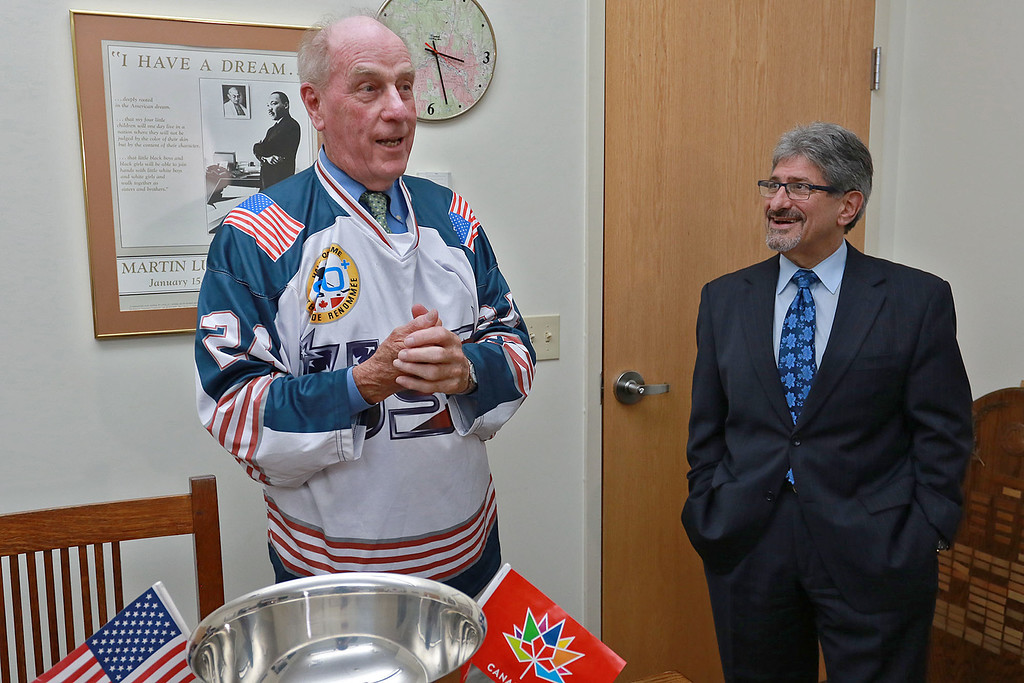 . Retired Fitchburg District court Judge Edward Reynolds played on the over 80 USA hockey team that played Canada in the Coupe Canada 150 Cup on Ottawa on October 28, 2017. The US bet Canada by a score of 3 to 2. Reynolds talks about the game when he visited Fitchburg City Hall on Thursday. Next to him is Mayor Stephen DiNatale. SENTINEL & ENTERPRISE/JOHN LOVE