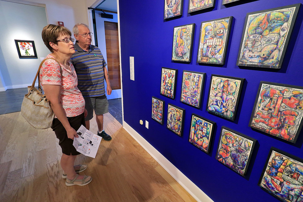 . Howard Johnson of Worcester has a show of his art at the Fitchburg Art Museum thjis month that he is calling Phantastrophies. Renata and Phillip Wiggin of Sterling take in the show on Friday afternoon. SENTINEL & ENTERPRISE/JOHN LOVE