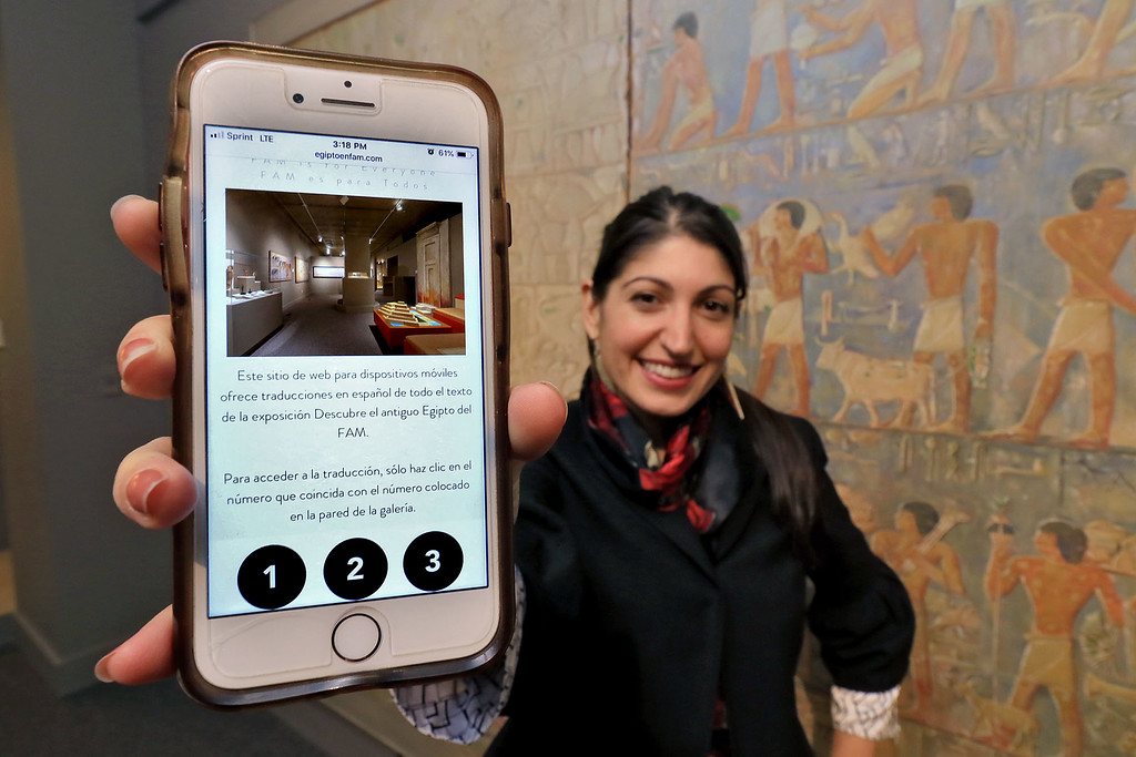 . The Fitchburg Art Museum has created an app for the museums Egyptian room that helps Spanish speaking guest be able to read about what each exhibit is. The rest of the museum is bilingual but this exhibit was not. This app will fix that. Kledia Spiro the museum\'s marketing manager show off the front page of the app in the Egyptian exhibit. SENTINEL & ENTERPRISE/JOHN LOVE