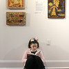 "Gallery Sitka in Fitchburg held a ""Comics Are Art"" show on Saturday. Lillianna Secino, 9, of Fitchburg reads her book below some wok in the show by Jen Hemenway. SENTINEL & ENTERPRISE/JOHN LOVE"