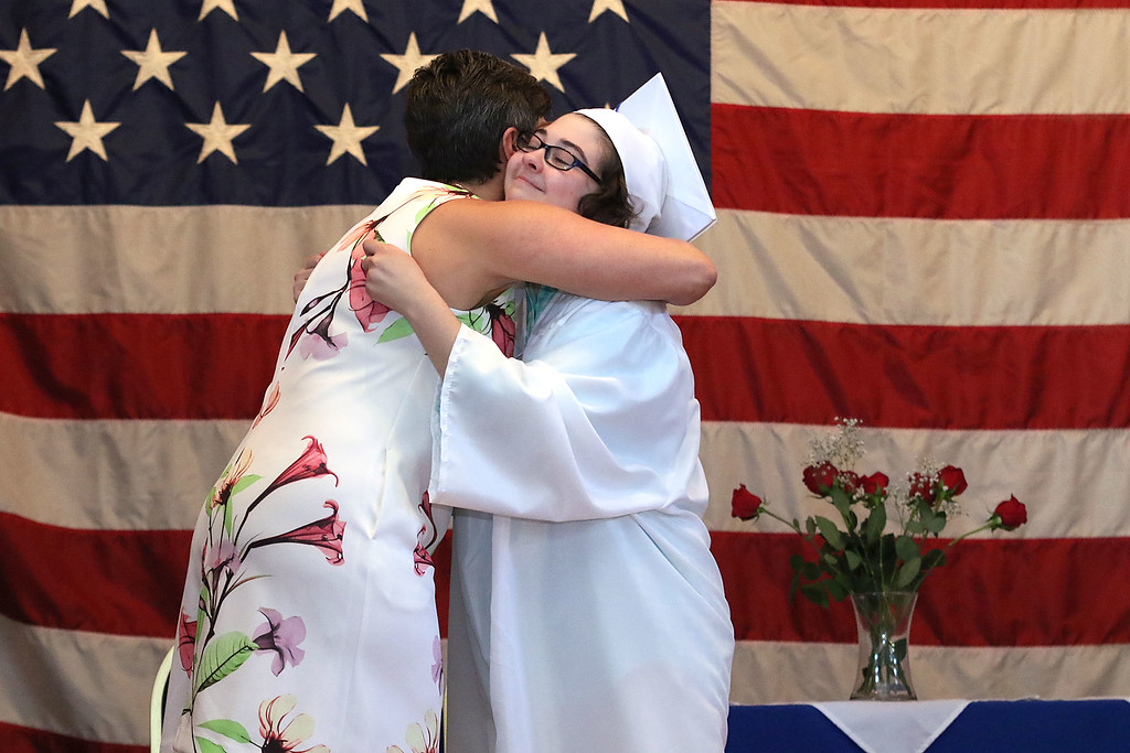 . Leominster Center for Excellence class of 2018 held their graduation ceremony on Thursday, May 31, 2018 at Leominster City Hall. This is just a few scenes from the graduation. Graduate Sarah Flynn hugs Principal Carrie Duff as she receives her diploma during the ceremony. SENTINEL & ENTERPRISE/JOHN LOVE