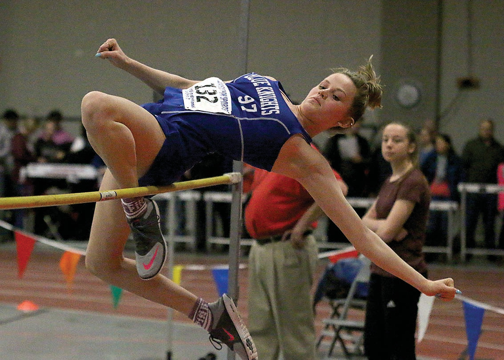 . The district track championships where held at Fitchburg High School on Saturday. leaping over the high jump bar is Lunenburg high School runner Nicole Lawrence. SENTINEL & ENTERPRISE/JOHN LOVE