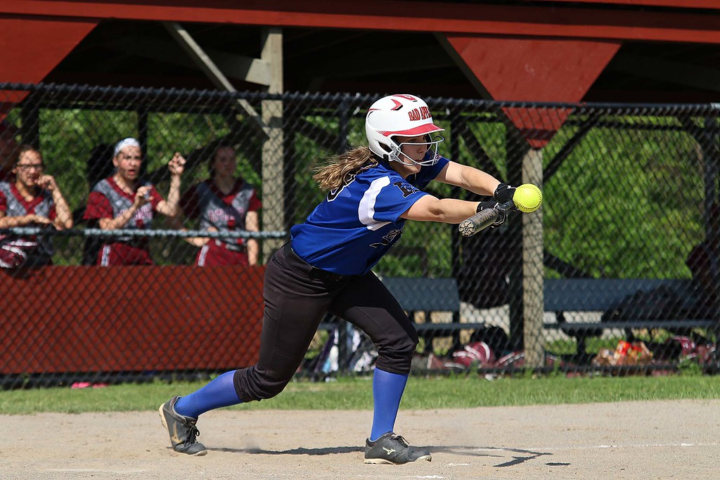. Leominster High School softball player Emma bBurkhardt bunts during their game against Fitchburg High School on Friday afternoon. SENTINEL & ENTERPRISE/JOHN LOVE