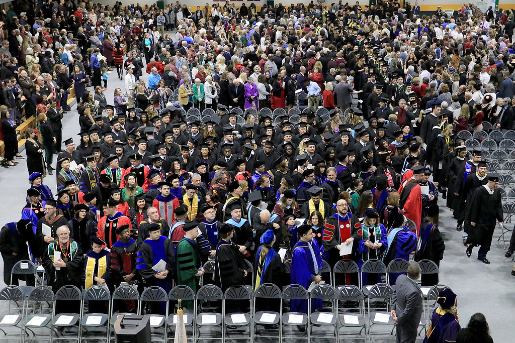 . Fitchburg State University held it\'s 122nd annual Commencement on Friday, December 21, 2018. Graduates make their way into the ceremony. SENTINEL & ENTERPRISE/JOHN LOVE
