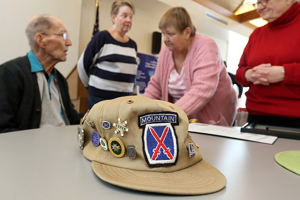 . Lunenburg resident and WWII veteran Clarence Goguen turned 100 years old last October and on Saturday at the Eagle House in Lunenburg he was given the Boston Post Cane as the oldest living person in town. His 10th Mountain division hat sits on the table as many come up to congratulate him after the ceremony.SENTINEL & ENTERPRISE/JOHN LOVE
