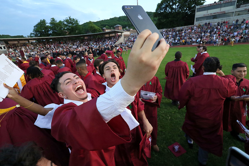 . Fitchburg High School held its 152 commencement exercises on June 1, 2018 Crocker Field in Fitchburg. Graduates cheer after throwing their caps into the air to end the ceremony. SENTINEL & ENTERPRISE/JOHN LOVE