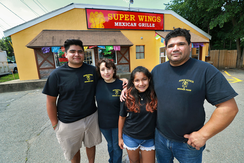 . After years of operating in a small building Super Wings has moved into a a new space. With a much larger kitchen and dining room, they\'re celebrating a big step forward. The restaurant is owned by the Garcia family. They posed for a picture out in front of the their new place on Friday afternoon. From left is cris, 19, Maria, Elena, 11, and Luis Garcia. SENTINEL & ENTERPRISE/JOHN LOVE
